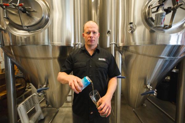 butcherknife-brewing-nate-johansing-pouring-a-beer