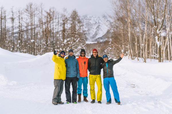 group photo excited after day of skiing mount yotei japan